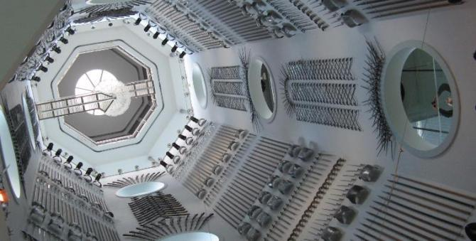 Hall of Steel, Royal Armouries Leeds. A steel & glass tower displaying over 2,500 pieces of armour & military equipment