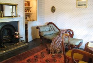 The reconstruction of Betsey Trotwood's charming parlour inside Dickens House