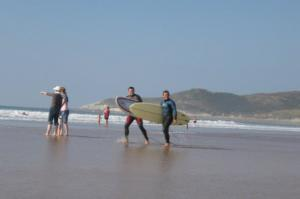 Surfing on Woolacombe Beach, North Devon Coast