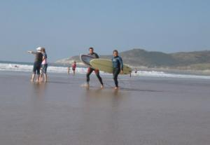 Surfing on Woolacombe Beach