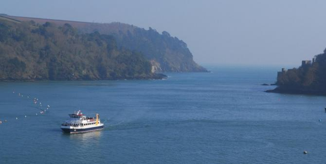 Leisure cruiser at the mouth of the River Dart