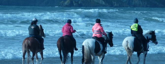 Riding along Newgale Beach on the Pembrokeshire Coast
