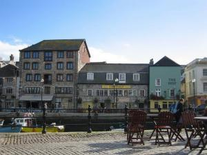 Plymouth Quayside lined with funky bars and old inns.
