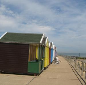 Colourful beach huts lining Southwold Beach