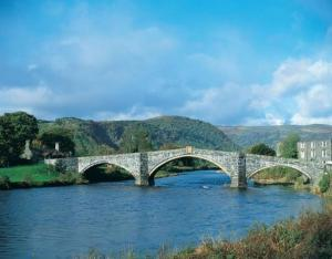 Browse places to stay in Llanrwst near the famous humpback bridge over the River Conwy.