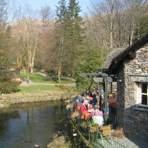 Riverside dining in Grasmere alongside the River Rothay