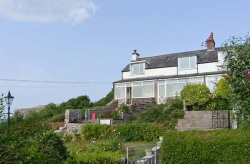 Last Minute Cottages - Two Bays and the Orme View Cottage