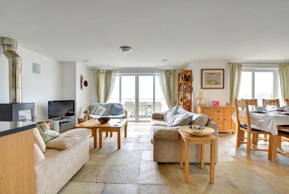 View of open plan living space with view of woodburner, ideal in Winter months, lounge and dining area - Sunridge