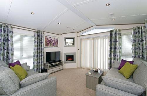 Last Minute Cottages - Luxury Mouswald Lodge S129001