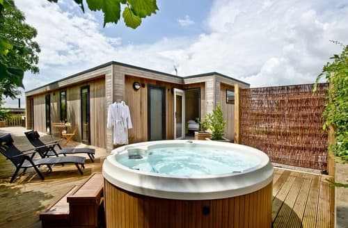 Log cabins with hot tubs - Late Availability, self catering log