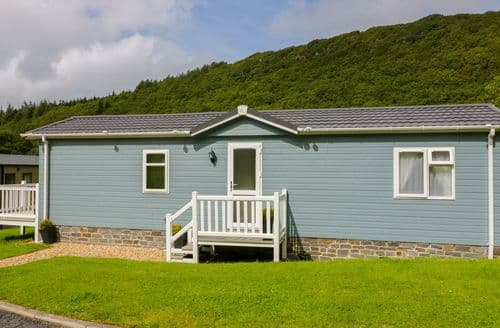 Last Minute Cottages - Cosy Gilfachrheda Lodge S85129