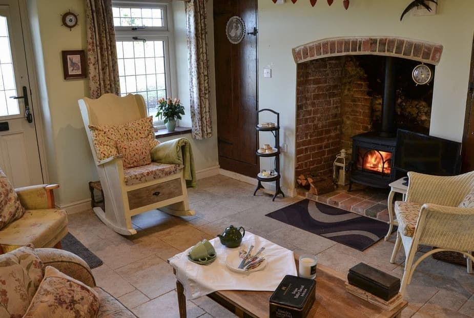 Lily Rose Cottage Cosy living room with wood burner | Lily Rose Cottage, Honing, near North Walsham