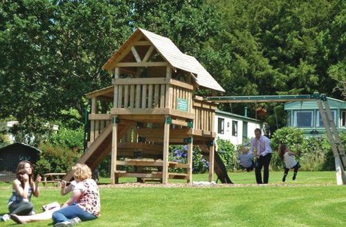 Snaptrip - Last minute cottages - Delightful Tavistock Lodge S69945 - Children's play area