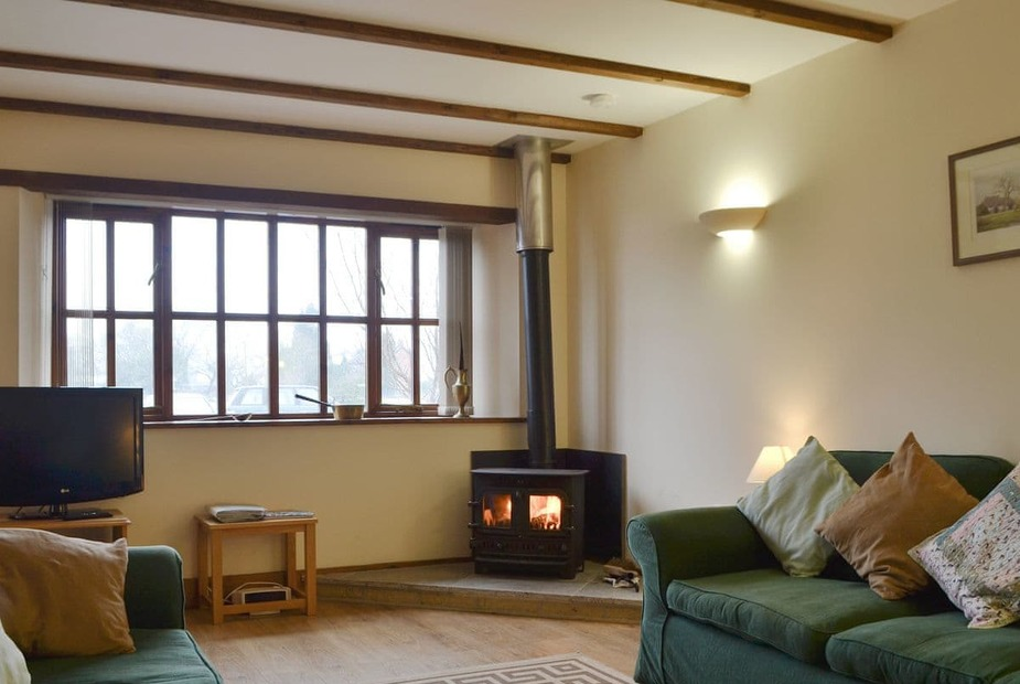 The Granary - UK10686 Cosy living area with wood burner | The Granary - Upper Kingston Farm Cottages, Ringwood