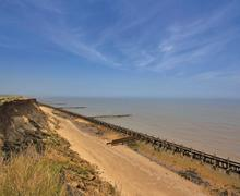 Snaptrip - Last minute cottages - Cosy Corton Lodge S72959 - Views from Corton cliffs at Waterside Park