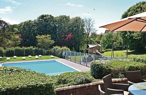 Snaptrip - Last minute cottages - Exquisite Weymouth Lodge S72960 - Outdoor heated swimming pool