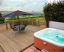 Snaptrip - Last minute cottages - Inviting Bishops Tawton Cottage S73564 - Relax in the hot tub and watch the sun go down