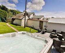 Snaptrip - Last minute cottages - Lovely Lobb Cottage S73577 - Newly installed hot-tub with large outdoor entertainment space