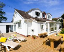 Snaptrip - Last minute cottages - Lovely Croyde Cottage S73601 - Decking, tables and chairs in the garden, perfect for a BBQ