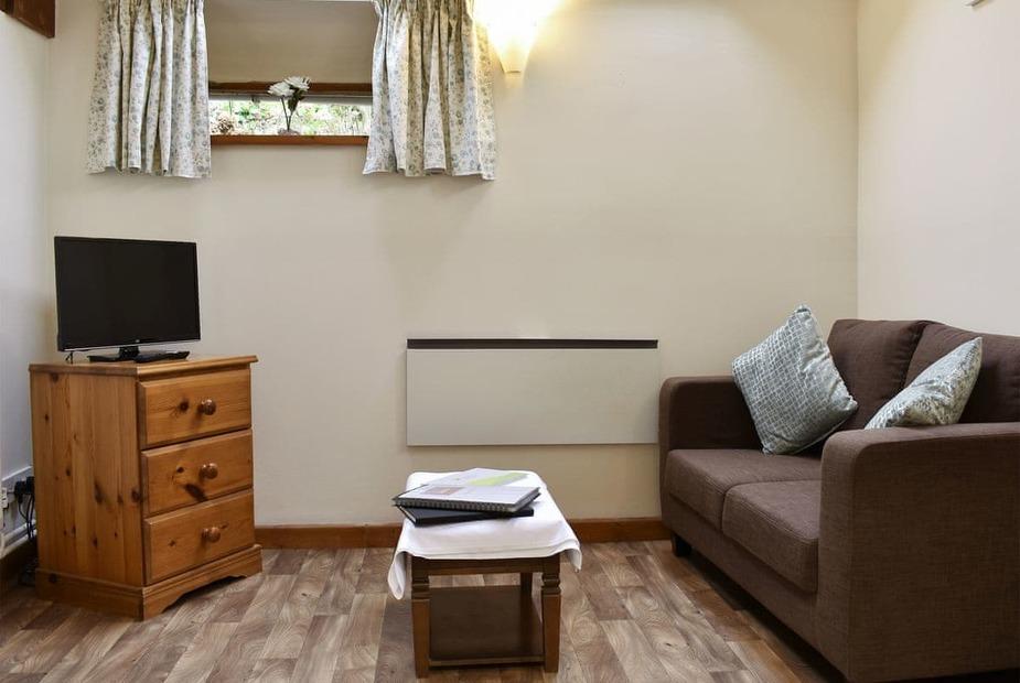 The Granary Charming living/ dining room | The Granary - Milton Abbas Cottages, Milton Abbas, near Blandford Forum