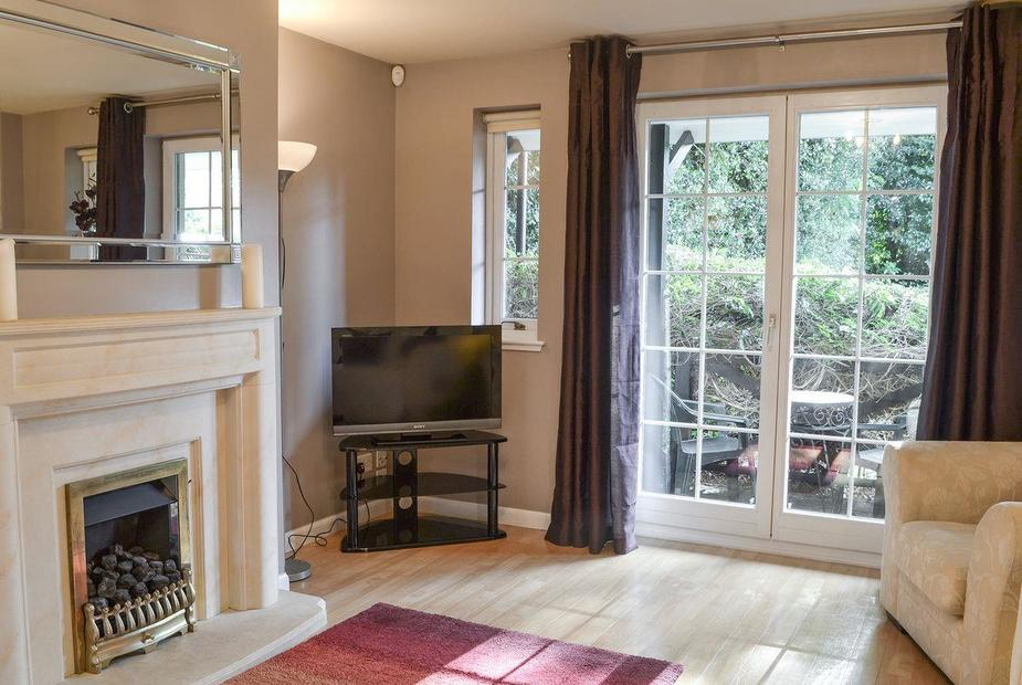 The Edens Living room with French doors | The Edens, Inverness