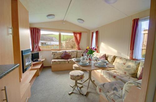 Snaptrip - Last minute cottages - Splendid Georgeham Rental S12322 - Sitting/Dining Area - View 1
