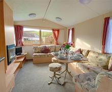 Snaptrip - Last minute cottages - Splendid Georgeham Rental S12322 - Sitting/Dining Area - View 1