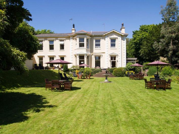 The Hotel Balmoral Victorian Villa Hotel with large landscaped gardens and sun trapped terrace with views out to sea.