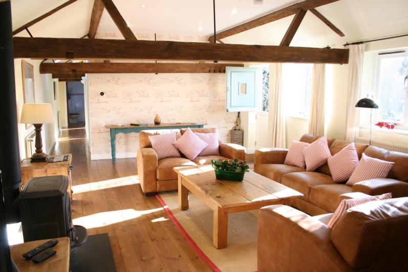 Oxford Country Cottages Blenheim-Cottage-Living-Room-with-log-burning-stove