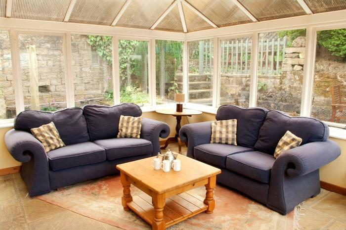 Holmelea Cottage Large Conservatory with upholstered settees the ideal place to relax.