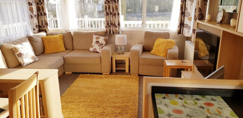 Living room is comfortable, warm and has great views - White Rose Holiday Home