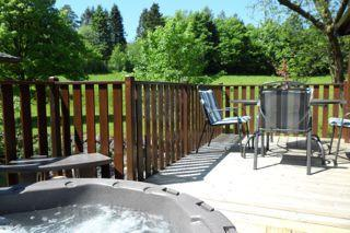 Troutbeck Lodges Tarn Hows Lodge Hot Tub in stunning location overlooking the beck and fields.