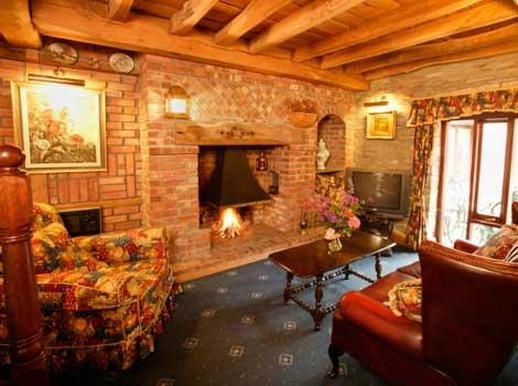 Dairy Cottage Cosy lounge with plenty of original features and exposed beams.
