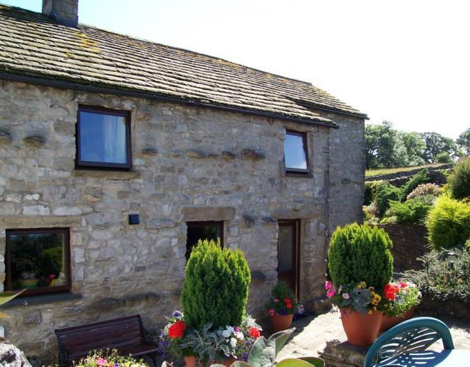 The Byres Holiday Cottage The Byres Holiday Cottage in the heart of Yorkshire Dales Three Peaks Country. Sleeps 2-6 + Cot.