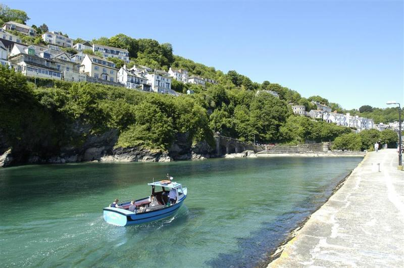 Amber Looe Harbour Entrance with boat - The Looe Harbour entrance