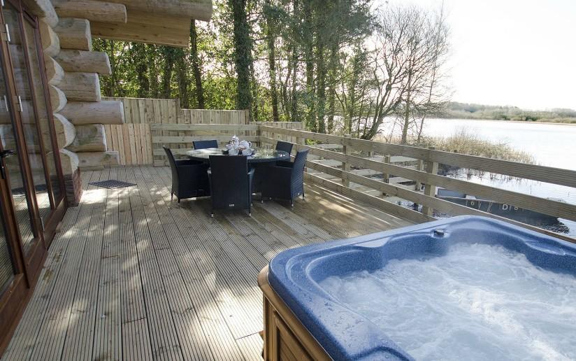Alder Lodge At The Tranquil Otter Alder Lodge - Hot tub with fantastic lakeside views.