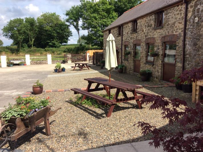 The Corn Loft, Longlands Farm Picnic benches outside your cottage and pretty planting