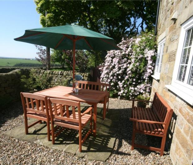 Smugglers Rock Cottages Smugglers View cottage private patio area. Sit and enjoy the sun and the view!