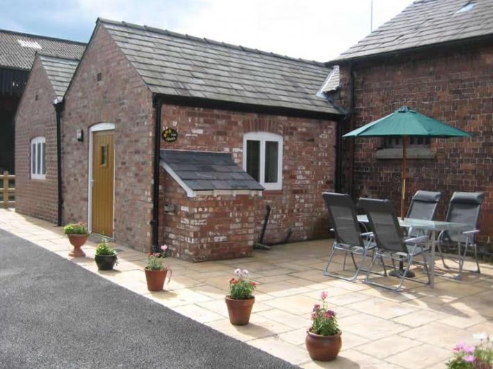 Martin Lane Farm Holiday Cottages Private driveway and patio area for The Stable