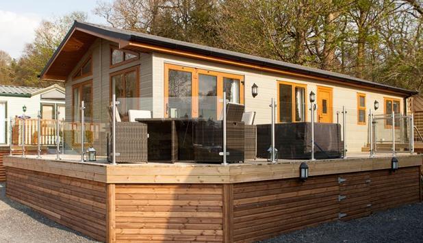 Dog Friendly Lake District Lodge Holidays Dog friendly 3 bed Lakeshore Lodge at White Cross Bay with lake views and hot tub.