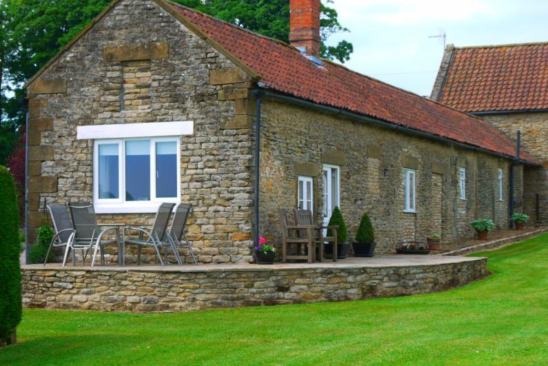Laura's Cottage Patio and seating area where you can sit and enjoy the picturesque view of the beautiful countryside