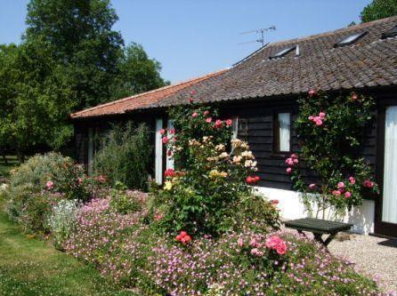 Barn Cottages Five pretty one bedroom cottages near Stowmarket set within 4 acres. Sleep 2-4.