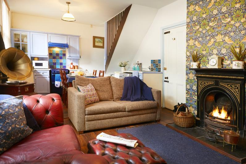 Brontes Rest Holiday Cottage Open plan living room with cosy open fire.