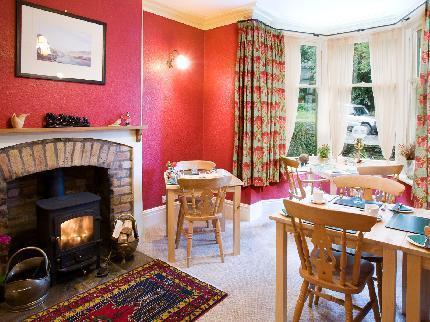 Dining room with wood burner - Burnside B&B