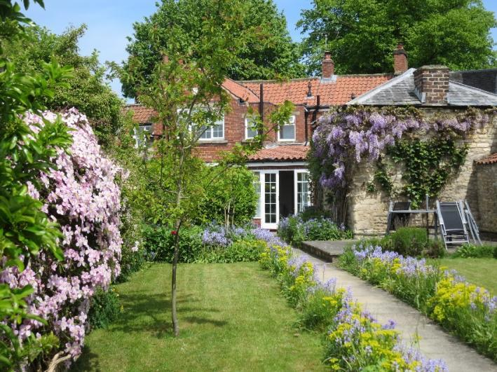 Eden House Holiday Cottage Our beautiful walled garden in full bloom - for guests to enjoy the tranquility