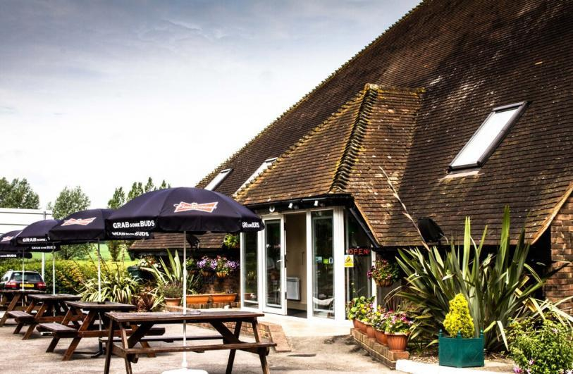 The Lodge at Winchelsea Exterior view and outdoor seating area.