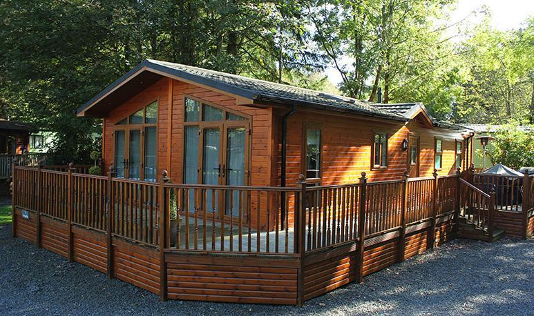 Oakwood Lodge Exterior - two bedroom luxury lodge with hot tub. Sleeps 4.  One well trained dog welcome.