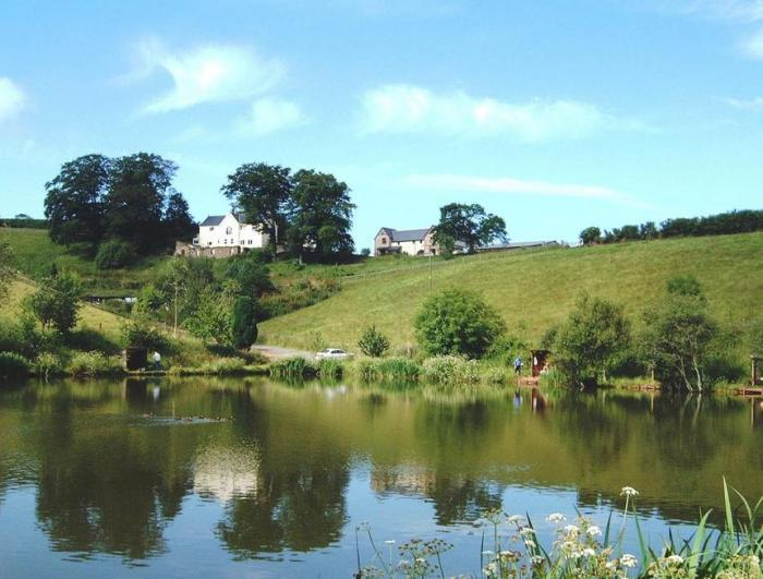 View of Badgers Holt Cottage at Newbarn Farm from the Mirror Lake.  - Badgers Holt Cottage