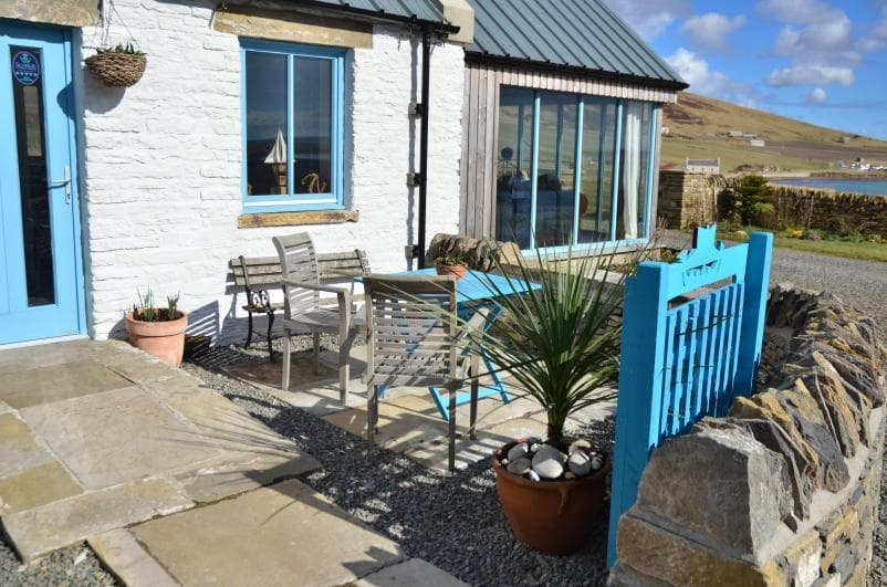 The Quoys of Houton Puffin Quoy - sleeps 2 - pretty exterior patio area with seating.