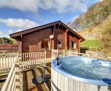 Snaptrip - Last minute cottages - Lovely Knighton Lodge S44740 - WAK297 - Exterior and Hot Tub
